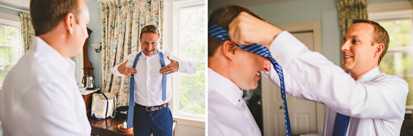 Groom helping brother with tie