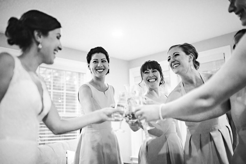 Bride with bridesmaids for celebration toast