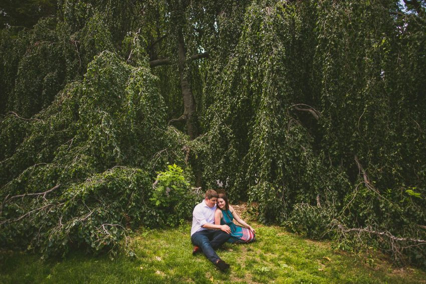 Couple sitting under willow tree