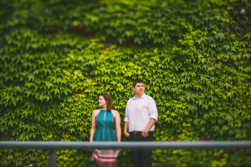 Engagement photo with vine wall