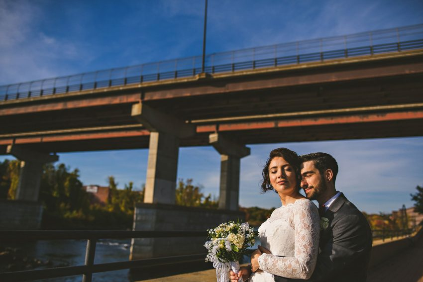 Dramatic wedding portraits under New Hampshire bridge