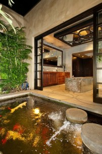 Bathroom opening up to a koi pond