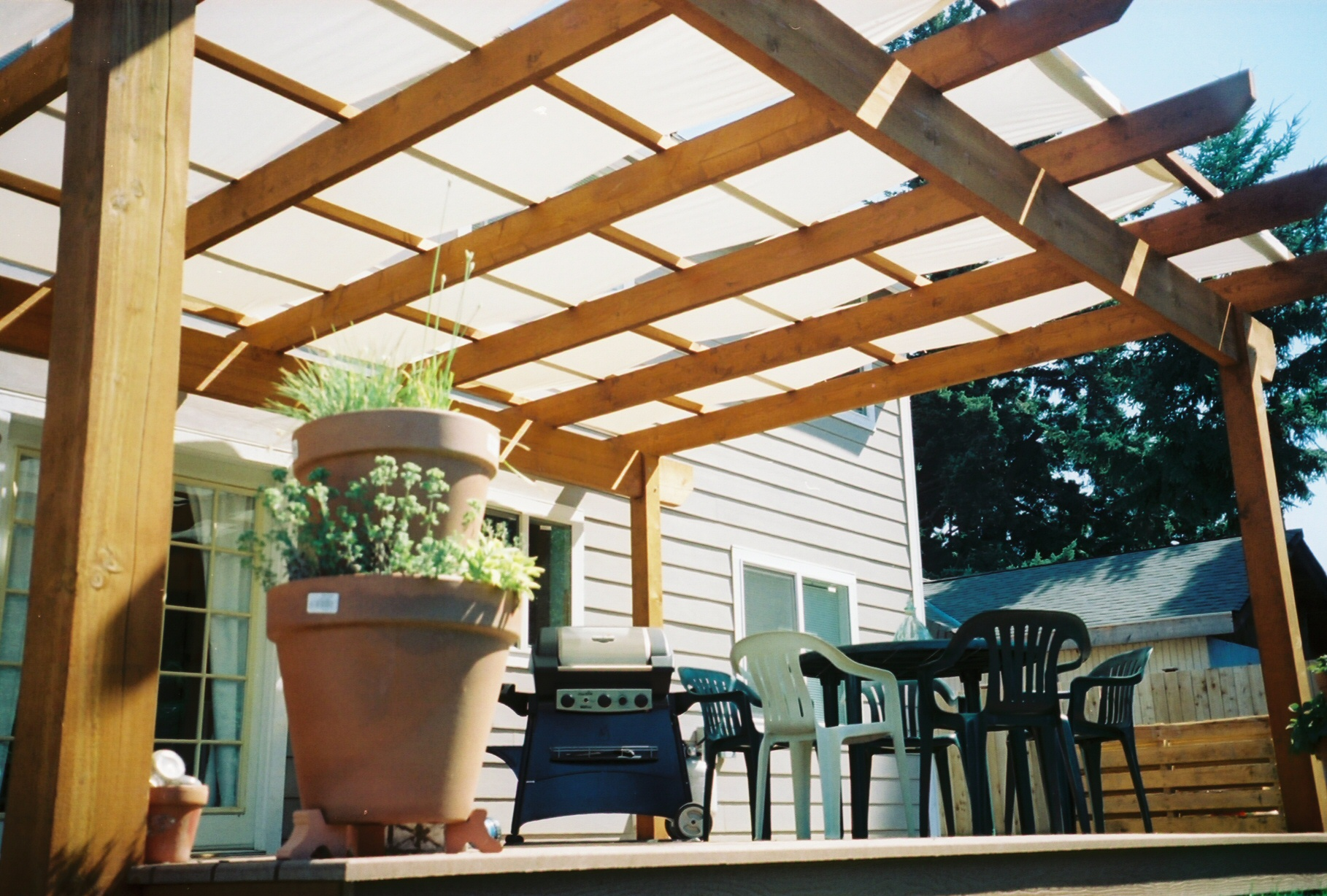 Control the Sun with Patio Covers | Alfresca Outdoor Living on Canvas Sun Shade Pergola id=79031