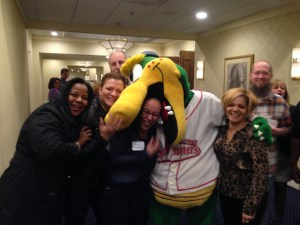 Attendees of the 2014 Leadercast North of Boston have a laugh with the Lowell Soinners mascot Canalligator.