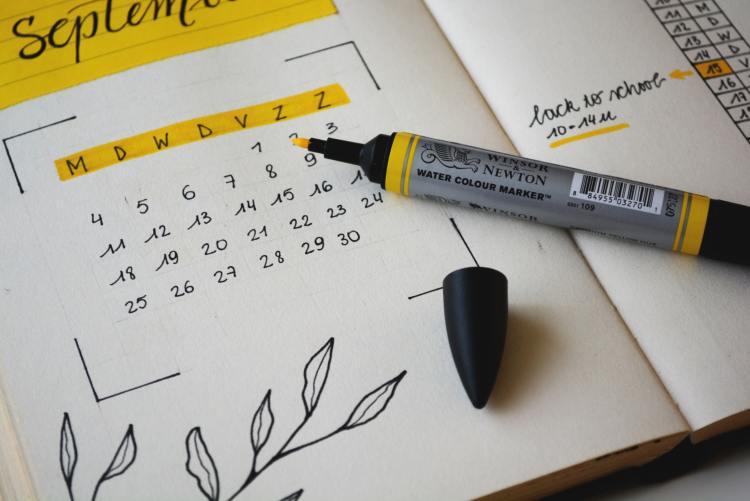 monthly planner written in cursive