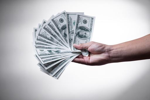 hand holding american paper currency