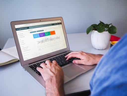 man working on SEO on laptop