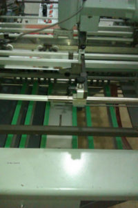 Reducing Printing Press Paper Board Cost