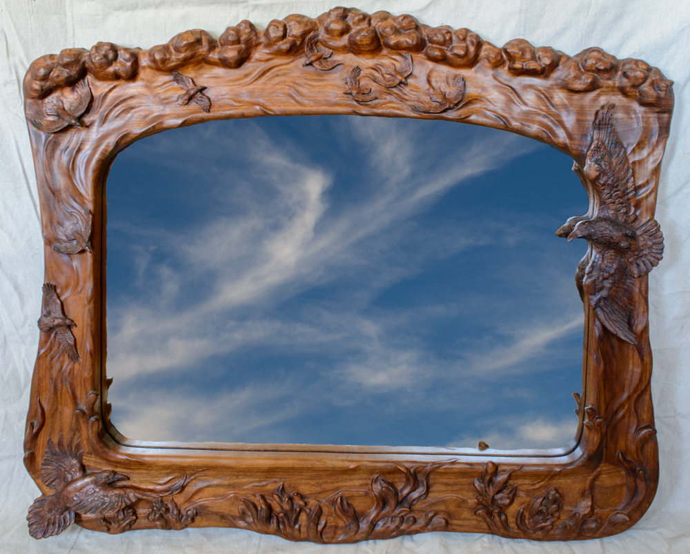 hand carved mirror with ravens