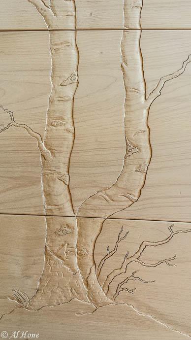 Carved aspen trees on dresser