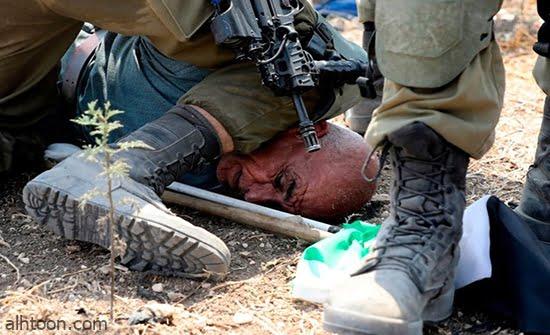شاهد: اعتداء قوات الاحتلال على شاب فلسطيني - صحيفة هتون الدولية