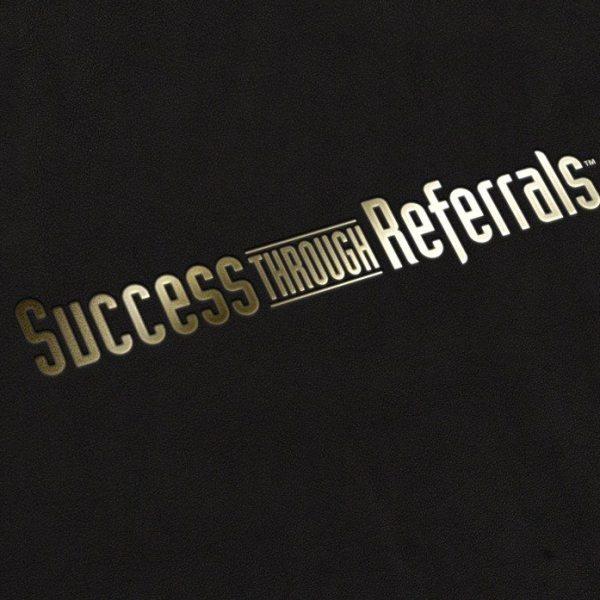 success_thru_ref_gold-stamping-logo-mock-up