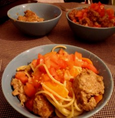 Creamy brie-filled meatballs (all the brie leaked out though) with tomatoes and pasta.