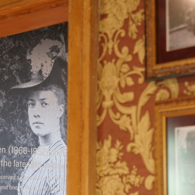 Photo of Alice Austen on the front wall of the permanent exhibition
