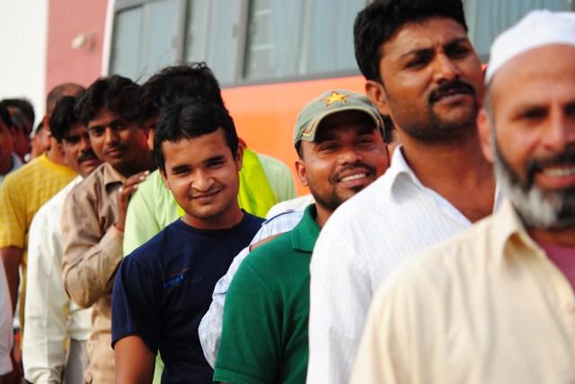 Always smiling Labourers waiting for Iftar Packs, Dubai Ramadan 2011: f/2.8; 1/3200sec; ISO-400