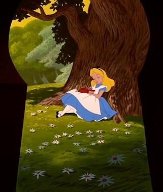 Alice looks at herself through the keyhole in Disney's Alice in Wonderland