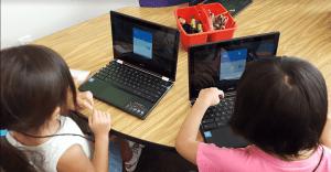 girls log into Acer Chromebooks