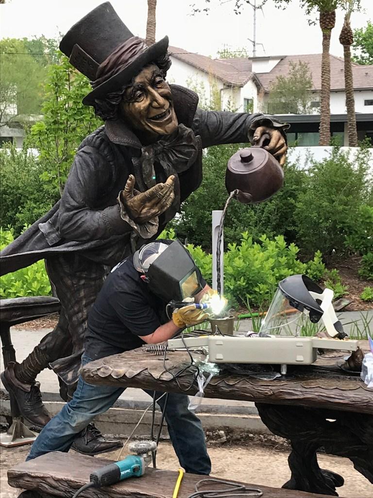 Mad Hatter is welded by Deep In The Heart Art Foundry. Bridgette Mongeon sculpted the Wonderland scene