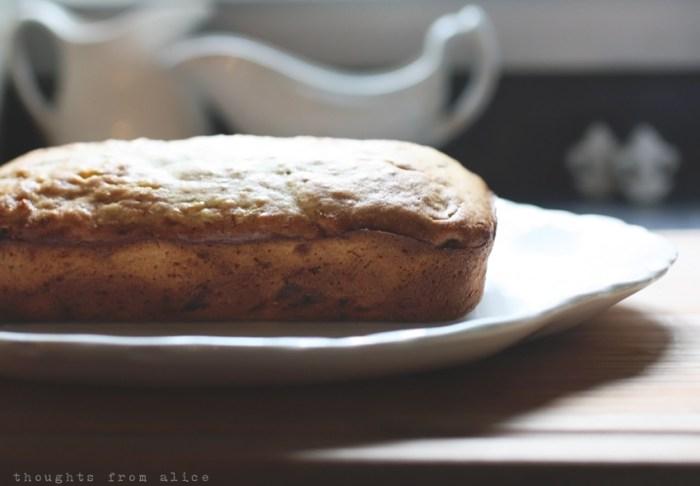 Baked banana bread on antique ironstone platter