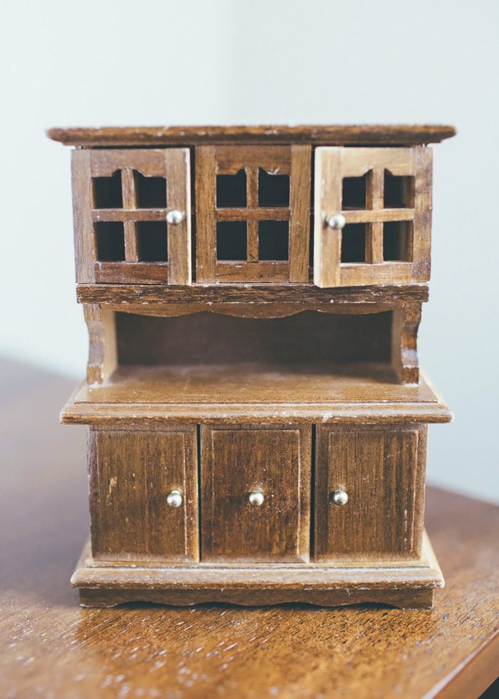 dark brown wood dollhouse hutch