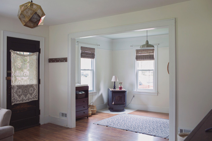Front entry and sitting room with baby changing station and corner pellet stove