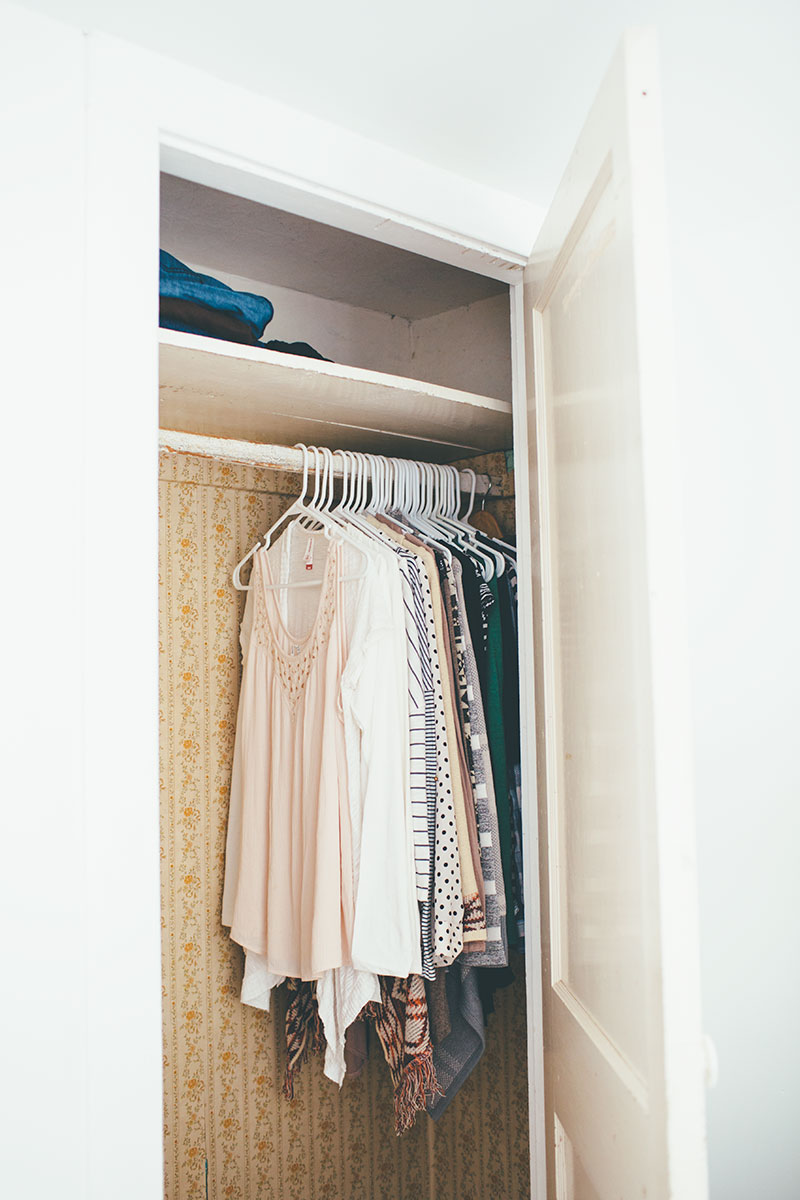 Small closet in older home with vintage wallpaper