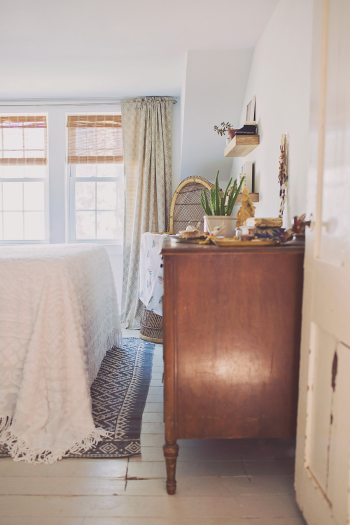 Bohemian Bedroom with Rattan Baby Bassinet
