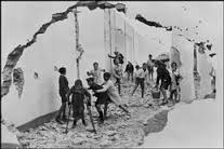Photograph by Henri Cartier Bresson of children in Seville, Spain