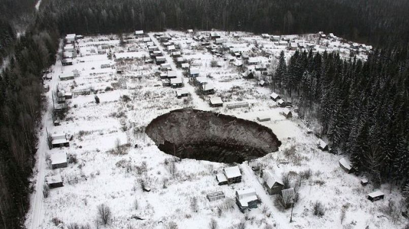 A view of a sinkhole, which stretches 20 meters by 30 meters, at the Solikamsk-2 mine in Russia's Perm region. IMAGE: TASS/ZUMA WIRE