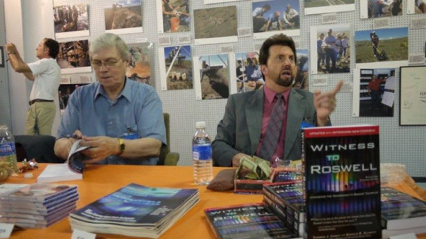 Don Schmitt (right) and Tom Carey signing books and talking to visitors in the Roswell UFO Museum. (image credit: Alejandro Rojas)