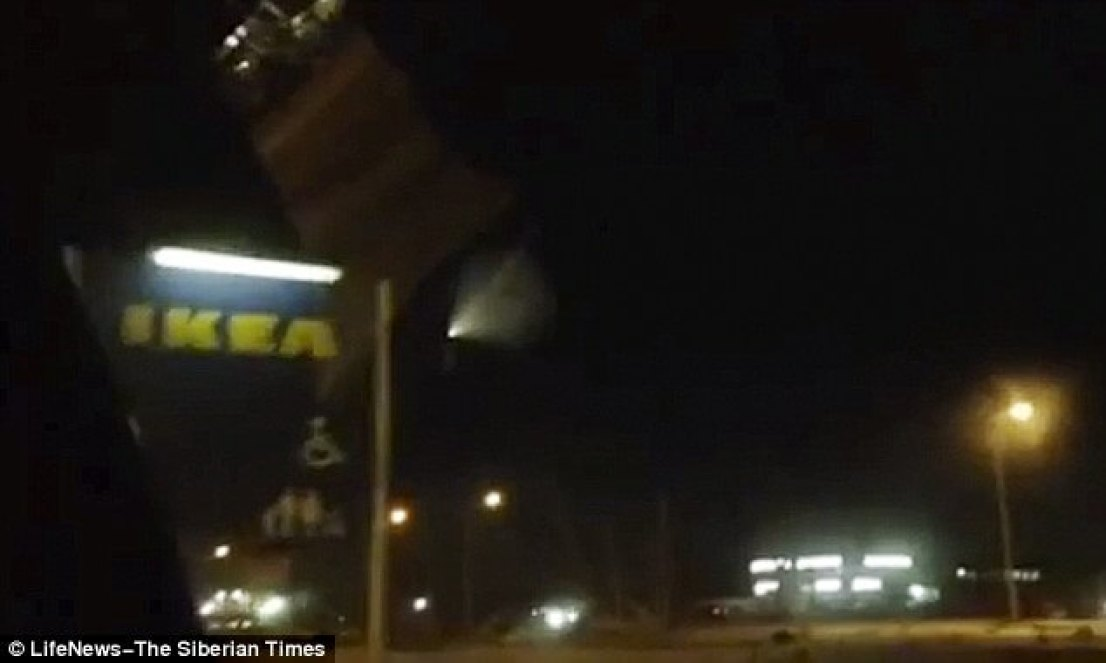 Footage of the mystery object taken from a car shows it flying over a branch of furniture giant IKEA in the city of Omsk, western Siberia
