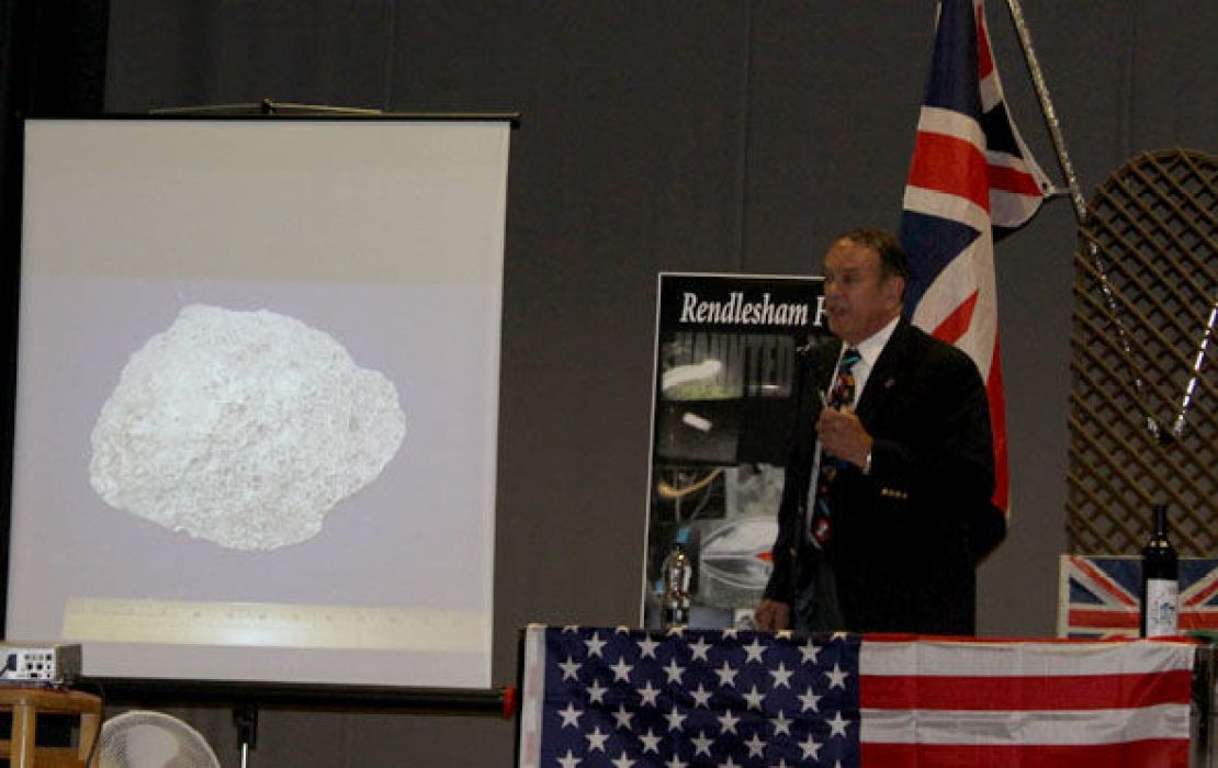 Charles Halt showing a photo of the missing plaster cast of one of the indentations