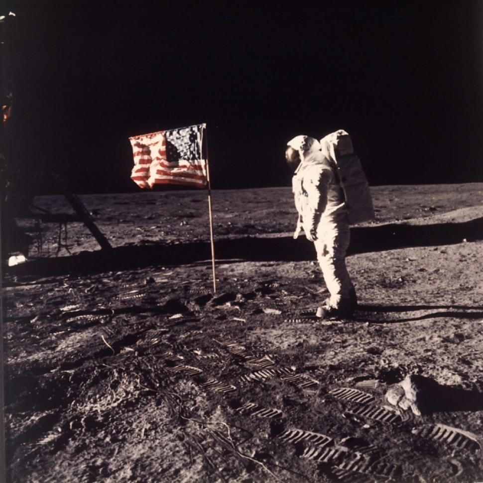 Astronaut Edwin (Buzz) Aldrin beside the U.S. flag planted on the moon during the Apollo 11 mission in 1969.