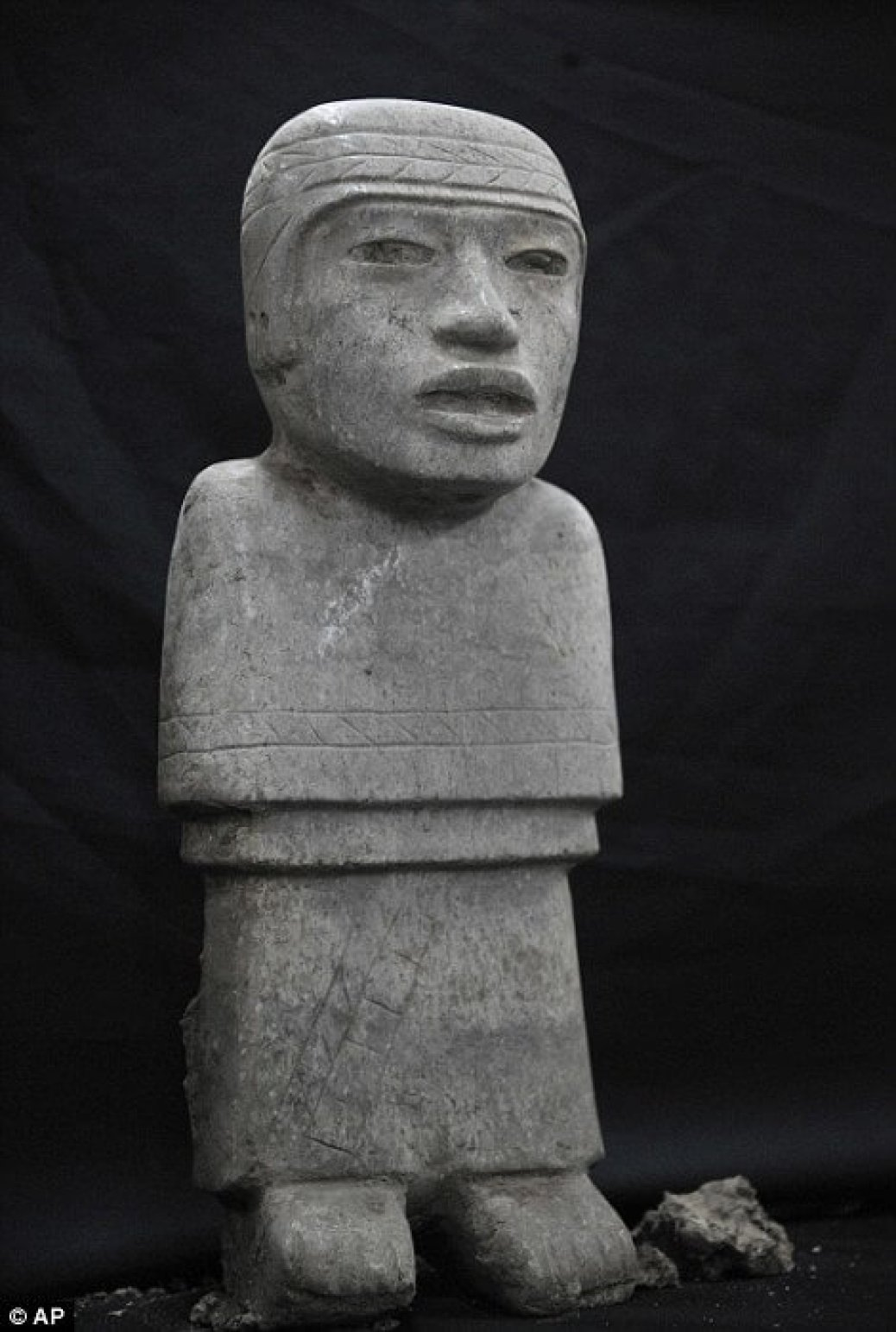 "Handout picture released by the National Institute of Anthropology and History (INAH in Spanish) showing a stone sculpture found at the Temple of the Feathered Serpent (Serpiente Emplumada) at the Teotihuacan complex in Mexico City, taken on October 25, 2014. Archaeologist Sergio Gomez announced in a press conference in Mexico City on October 29, 2014 that new discoveries were made recently at the temple. The discovered offering is located at 103 metres from the entrance of the temple and contains thousands of items including 4 stone sculptures and jade ornaments. AFP PHOTO/INAH --- RESTRICTED TO EDITORIAL USE - MANDATORY CREDIT ""AFP PHOTO /INAH"" - NO MARKETING NO ADVERTISING CAMPAIGNS - DISTRIBUTED AS A SERVICE TO CLIENTS--/AFP/Getty Images"