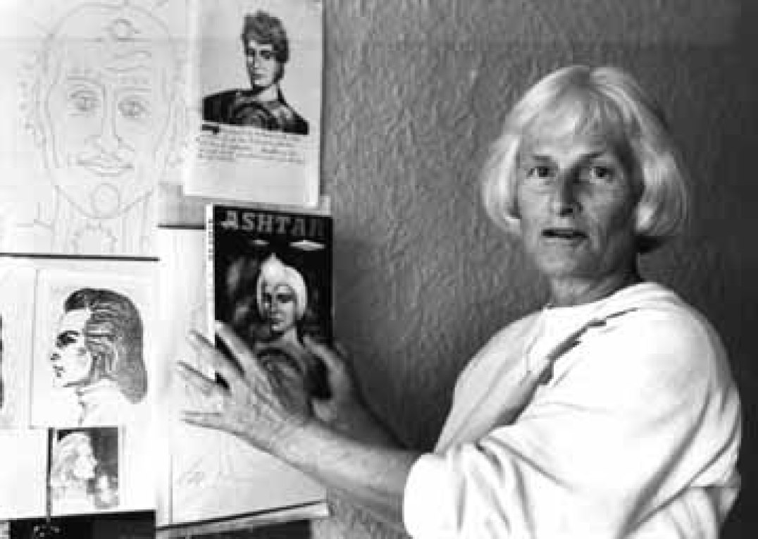 Carole Austen examines a drawing of extraterrestrial being Ashtar.</cite