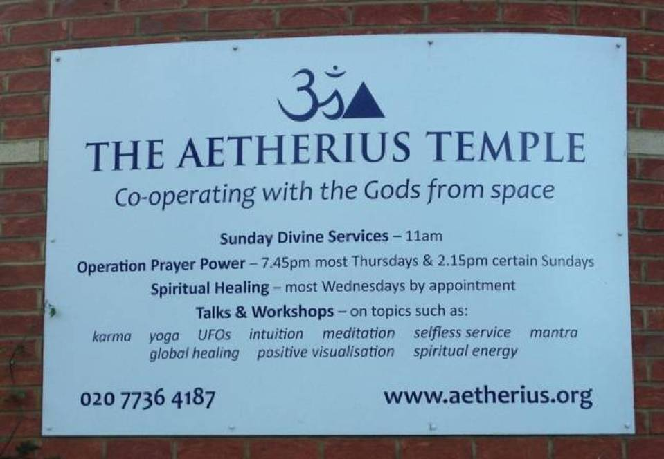 A sign outside the Aetherius Temple in Fulham advertising services.