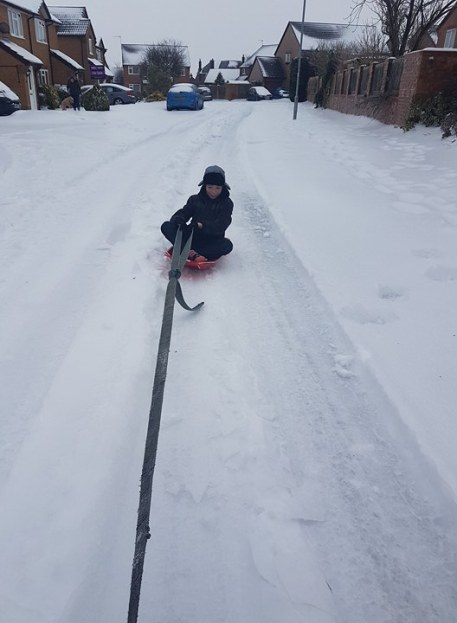 snow day sledging