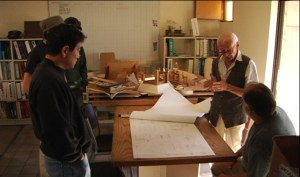 Paolo Soleri discussing the plans.