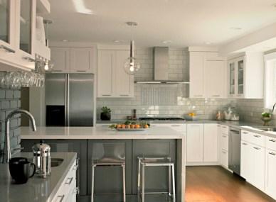 Transitional Kitchen by Crisp Architects