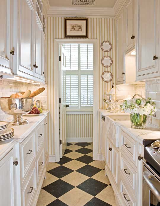 Glam Galley Kitchen with Calcutta Marble, Neutral Finishes by Gerald Pomeroy