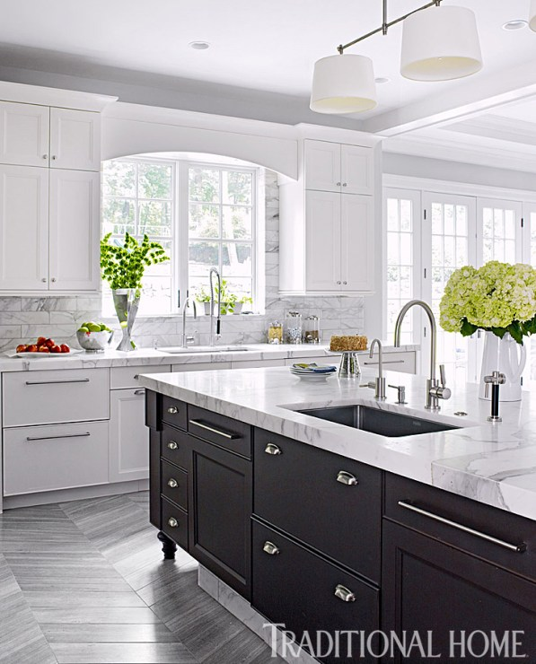 Dark Stained Walnut Island Cabinets offer Contrast to White Cabinetry by Rutt, Two Franke Sinks, Two Bosch Dishwashers and Wide Aisles Accommodate Multiple Cooks