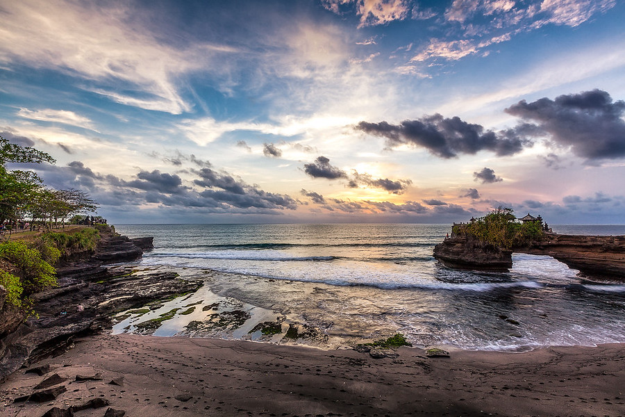 Batu Bolong - BaliBatu Bolong Temple is just West of Tanah Lot in Bali Indonesia. I preferred shooting here since there was way less people along the beach and on the cliffs.