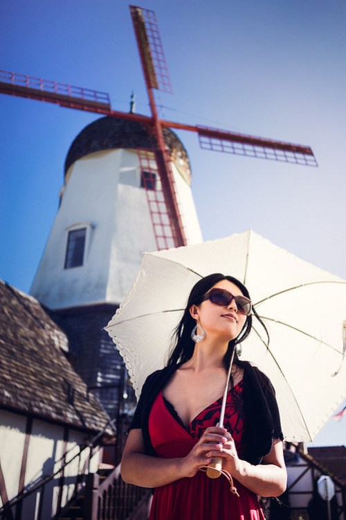 Yumiko at Solvang in front of a windmill.