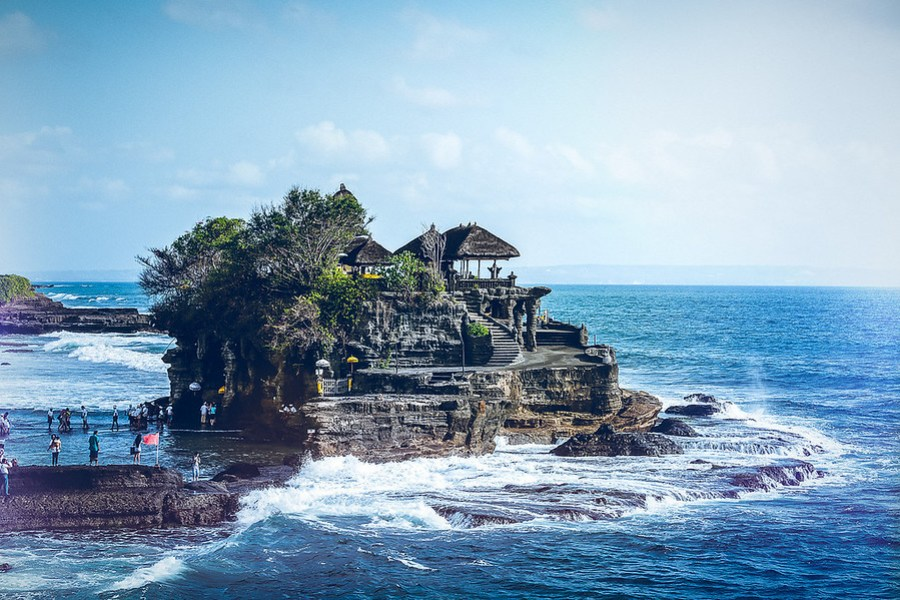 Tanah Lot the Sea Temple. Tanah Lot is the Temple in the Sea and is a very popular tourist spot of Bali Indonesia. Learn more about my photography at AlikGriffin.com