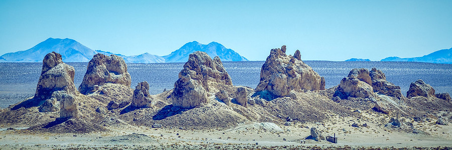 Pinnacles of Trona. The Amazing Pinnacles of Trona near Death Valley California. These Pinnacles were created in an ancient lake bed that once sat here. It was blindingly bright the day I took this photo. I really was wishing for some clouds or some weather but it was too perfect of a day for photography. These pinnacles are also much larger than they look.