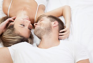 Young romantic couple in bed
