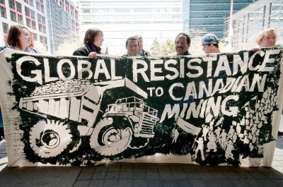 Mining justice activists from Papua New Guinea and Canada demonstrate in Toronto, Ontario, 2010. Photo Credit: Allan Lissner