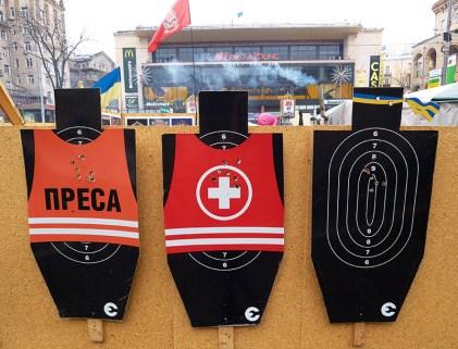 Press and medics riddled vests