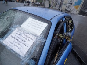 "Automaidan activist's car, ruined by ""Berkut"" (riot police)"