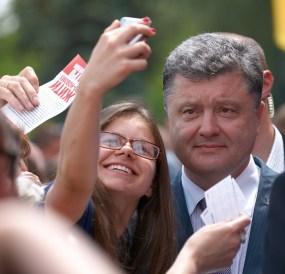 Girl takes a photo with Poroshenko